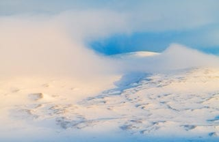 Clouds resting on snow